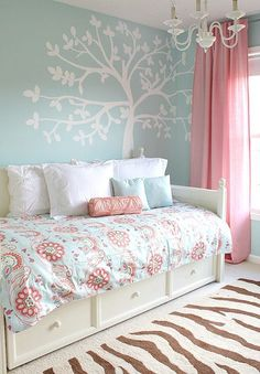 Paint a tree mural using chalk and a projector. Beautiful pink and blue colors for a girl room.