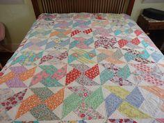 Vintage handmade pinwheel quilt