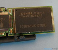 """The second chip which is shown in the image above is a NAND type flash memory which has fast read, write and erase cycles. The data is stored in memory cells of the EEPROM, known as """"floating gate transistors"""" - a regular metal-oxide field effect transistor (M0SFET) consisting three terminals - source, gate and drain. The storage capacity of this memory is 2GB. There is another similar chip with storage capacity of 2GB on the other side of the PCB."""