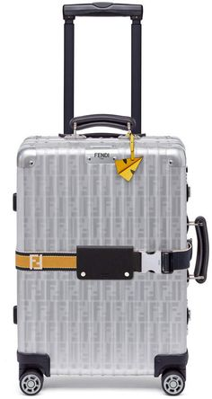 Buy and sell authentic handbags including the Fendi x Rimowa Cabin Trolley Luggage Zucca Yellow Web Belt Silver in Aluminum/Leather with Silver-tone and thousands of other used handbags. Cabin Suitcase, Hard Suitcase, Cabin Luggage, Carry On Luggage, Fendi Backpack, Luxury Luggage, Designer Luggage, Rimowa, Luxury Handbags