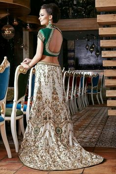 Indian Bridal Lehenga emerald and pearl combination! This is perfect for olive skinned and white skinned alike..! The blouse has such a deep and seductive back...keeps out the monotony from the bridal lehengas!