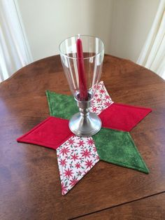 Christmas Quilted Star Candle Mat Red Green and Beige by seaquilt