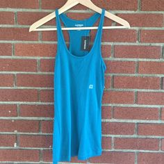 Racerback tank from Express Beautiful blue color (last picture shows the color the best). Never worn, tags still on. Perfect for fall layering or with a pair of shorts in the summer! Bundle and save! Make me an offer  Express Tops Tank Tops