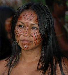 Amazonian wearing tribal makeup