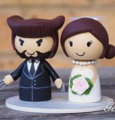 cute-wolverine-logan-superhero-wedding-cake-topper-genefy-01
