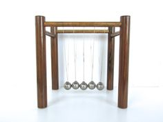 Large Mid Century Modern Newtons Cradle, Kenetic Sculpture, Wood And Steel Ball Executive Desk Swinging Wonder by HerVintageCrush on Etsy