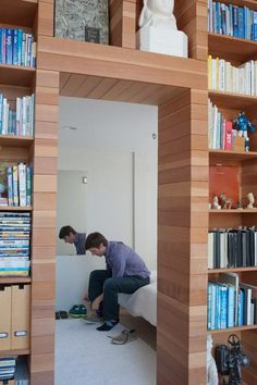 http://www.marvelbuilding.com/wp-content/uploads/2012/07/bedroom-entrance-of-An-Extraordinary-Multifunction-Wooden-Box-in-A-Loft.jpg