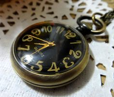 Vintage Black and Yellow Pocket Watch Necklace by HaHaCup on Etsy, $3.99