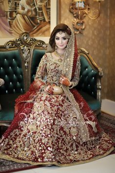 Red and gold combination is always perfect in a heavily embroidered bridal wear Asian Bridal Dresses, Bridal Mehndi Dresses, Asian Wedding Dress, Pakistani Wedding Outfits, Indian Bridal Outfits, Bridal Dress Design, Indian Bridal Wear, Pakistani Wedding Dresses, Pakistani Bridal Makeup