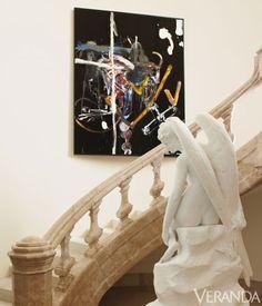 Custom stone staircase. Painting, Julian Schnabel. Angel, Damien Hirst.