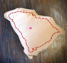"""Show a little state pride with these simple and cute """"stitched"""" outline state designs. You can even turn them into a simple shaped pillow for some extra unique decor. Add a tiny icon to mark the spots you love!"""