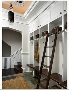 laundry room- We have these in our laundry room, minus the ladder, but I LOVE the ladder idea!
