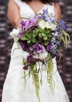 This succulent cascade bridal bouquet is perfect for the contemporary bride and is truly one of a kind. Flowers are customizable to the season and colors of your wedding.    House Of Magnolias would love to create something for the bride, the groom, and the entire wedding party