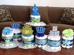 I keep getting these as custom orders, So I decided to list them.  Each mini cake is$10.50 with 7 size one diapers.  Toppers include ( Castle, I have three different styles of crowns), gerber flower frog king, Bath Duck ( banks no longer available) Frog Teethers are out of stock. Booties are $12for the mini cakes  Bundt Cakes with 16 size one diapers are $12.50 $14.00with the booties Two tier cakes are $25 with a teether and 25 diapers. 3 Tier with socks, teether, 60 size one diapers, fork…