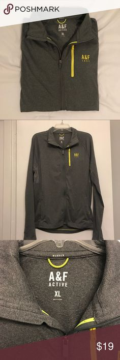 Men's Abercrombie active zip Active full-zip from Abercrombie & Fitch in a size XL. Features yellow accents and a small reflective strip on the back. 88% polyester, 12% elastane. Excellent used condition. Abercrombie & Fitch Shirts