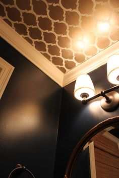 Plain painted walls and patterned wallpaper on the ceiling