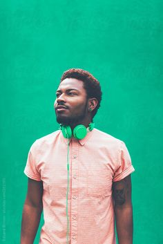 Stock photo of Portrait of modern young black man with headphones in front green background. by BONNINSTUDIO Modern Photography, Photography And Videography, Color Photography, Creative Photography, Portrait Photography, Photography Ideas, Professional Portrait, Young Professional, Black Boys