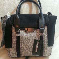 """NWT Steve Madden Satchel NWT Steve Madden Satchel. It has removeable and adjustable crossbody strap too. Measurements 10.5 """" x 11"""" x 4"""". Strap drop 5.5"""". Steve Madden Bags Satchels"""