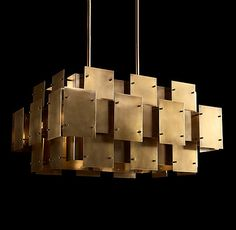 """RH Modern's Constructivist Panel 30"""" Chandelier:Inspired by 1970s postmodernism, geometric rhythm and industrial glamour take center stage in Robert Sonneman's striking pendant. Flat panels of lacquered burnished brass overlap in tiered levels, creating dramatic sculptural relief and complex spatial interplay."""
