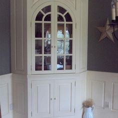 This Is A Built In Corner Hutch With Arched Glass Doors. Itu0027s Custom Built  To Intergrate With Custom Wainscoting In A Dining Room.
