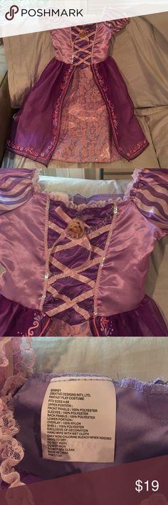 Girls Rapunzel costume size 4-6 Worn once, great condition girls Rapunzel costume.  Retails for $40! Disney Dresses
