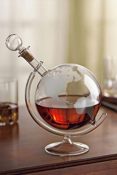 "A real conversation piece for the spirits lover in your life. The lovely globe decanter is beautiful and unique. It spins on it's stand and it's a gift that's ""worldly"" enough for all spirits enthusiasts. This lead free decanter is fragile and recommended to be hand washed. Dimensions: 9 x 7 inches Weight: 1.8 pounds Free shipping on qualifying orders. #bourbonandboots"