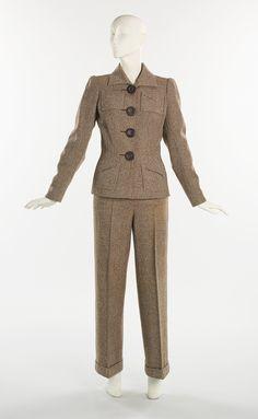 Pantsuit, ca. 1939.  Elsa Schiaparelli (Italian, 1890–1973).  Brown wool tweed, brown leather.  L. at CB (a) 28 in. (71.1 cm), (b) 43 in. (109.2 cm).