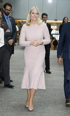 Princess Mette Marit donned a long-sleeved nude midi dress to carry out an engagement in Canada.<br><br>Photo: © Getty Images