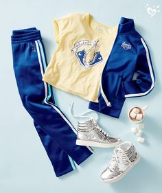 Feeling a bit more casual? Pair a graphic tee with a track jacket and made-to-match pants. Add metallic sneakers for an extra kick of glitz!