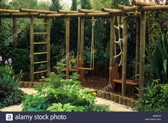 child friendly wooden climbing apparatus in corner of garden Stock Photo