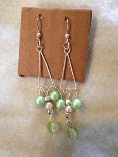 Metallic green and silver handmade chandelier earrings.  www.etsy.com/shops/nealycreations