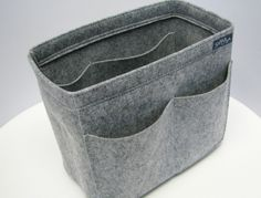 SamorgaS3(W9 H8 D4.8in) Felt organizer bag insert  It has total 10 pockets.  - The middle part is fitted with velcro so you can remove /attach it for your purpose.     Size:  Width: 23cm , about 9in  Height: 20cm, about 8in  Depth: 12cm, about 4.8in  Color:light grey
