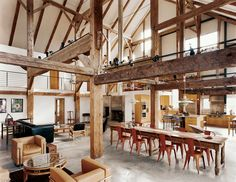 """We didn't want to diminish the openness and height and feeling of a great expanse of space,"" says Arnold, though he adds, ""I was slightly concerned that we were going to end up feeling like we were reading in Grand Central Station."" Fortunately, the barn frame's horizontal beams perform a domestic function by creating the illusion of a lower ceiling. The three major anchor beams were hewn from a single tall yellow pine."