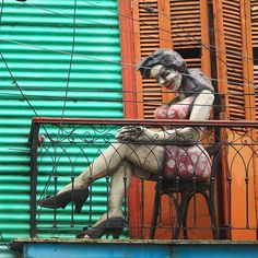 """This sculpture and its colorful setting in La Boca Buenos Aires Argentina is representative of the cultural artistic heritage of the city that earned it the name """"Paris of South America""""."""
