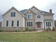 24 Jonathan Trail, Glastonbury, CT. Jacques & Son signature home with distinguishing millwork, spectacular kitchen, and a great open floor plan for entertaining! 4 bedroom, 4 bathrooms, and a 4 season porch off the kitchen. $739,999