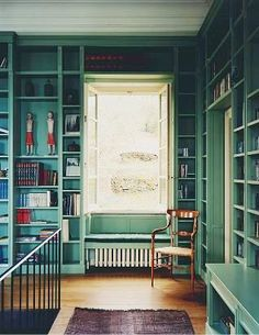 library built into an upstairs hallway - love the color!!!