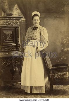 Circa 1880s cabinet card photograph, house maid in Taunton, Massachusetts. - Stock Image