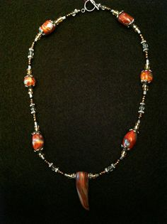 Savanna Wilds necklace. Hand made polymer clay beads including tooth! SOLD
