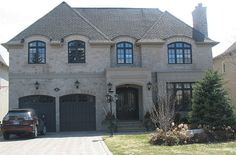 Indiana Limestone Rubble front wall, smooth Indiana Limestone panels door surround by CWB MTL, via Flickr
