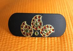 This Tanjore hair clip is a classic ethnic accessory that goes perfectly with all Indian wear. It is suitable for...