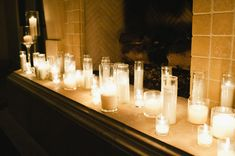 Candle-Wedding-Mantle.... like the idea of different size/style candles