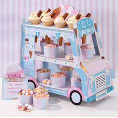 Our Ice Cream Truck Stand will definitely be a showstopper at your next party! The perfect party display for ice cream, cupcakes or sweet treats. Our 3 Tier Stand includes 12 paper ice cream cones, bo