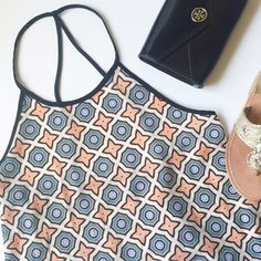 ⏬ Strappy Geometric Print Tanktop Absolutely love the geometric print and colors of this blouse • Flowy fit, would look best on a Small or Medium • high-low style & could be worn as a tunic • lightweight material • show off some bronzed skin this summer with this trendy piece☀️ Tops Tank Tops