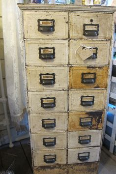 the perfect industrial cabinet with great, old white paint...Great in a prim scrapbook room...