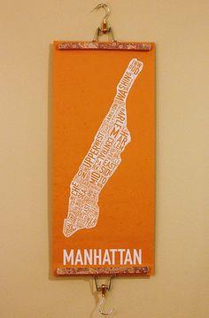 skirt hanger decoupaged for hanging artwork and the like.