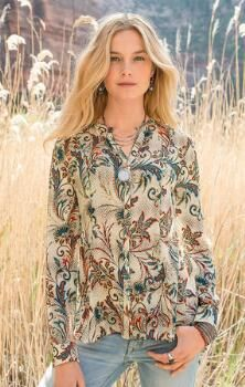 A unique, hi-lo silk blouse sure to lend a touch of elegant interest to any look.