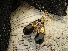 Jet Black and Antiqued Gold in a classic 1920s teardrop earring, only 1 inch long.