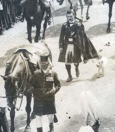 King Edward VII's beloved terrier Caesar marches in the King's funeral procession, 1910.