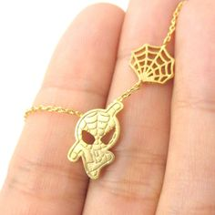 - Details - Sizing - Shipping A necklace inspired by Marvel's super hero Spider-Man! It features a small Spider-Man charm in gold and it looks like it's hanging from a spider web! Store FAQ | Returns