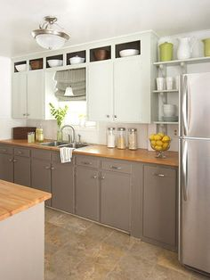 I like the open shelves above the upper cabinets.  Nice color on the lower cabinets.